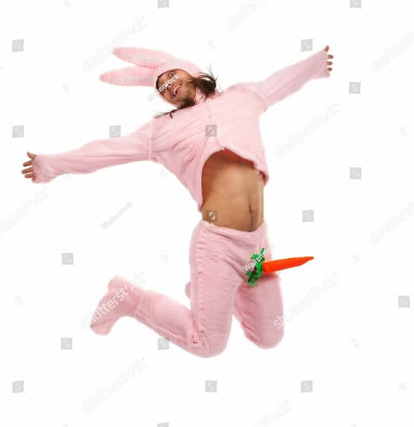 man in a easter bunny outfit and the carrot is his penis