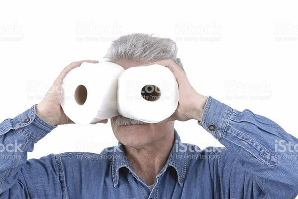 man using toilet paper as binoculars WTF stock photos