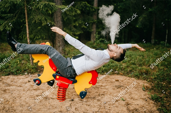 WTF stock photos vaping in a kids park