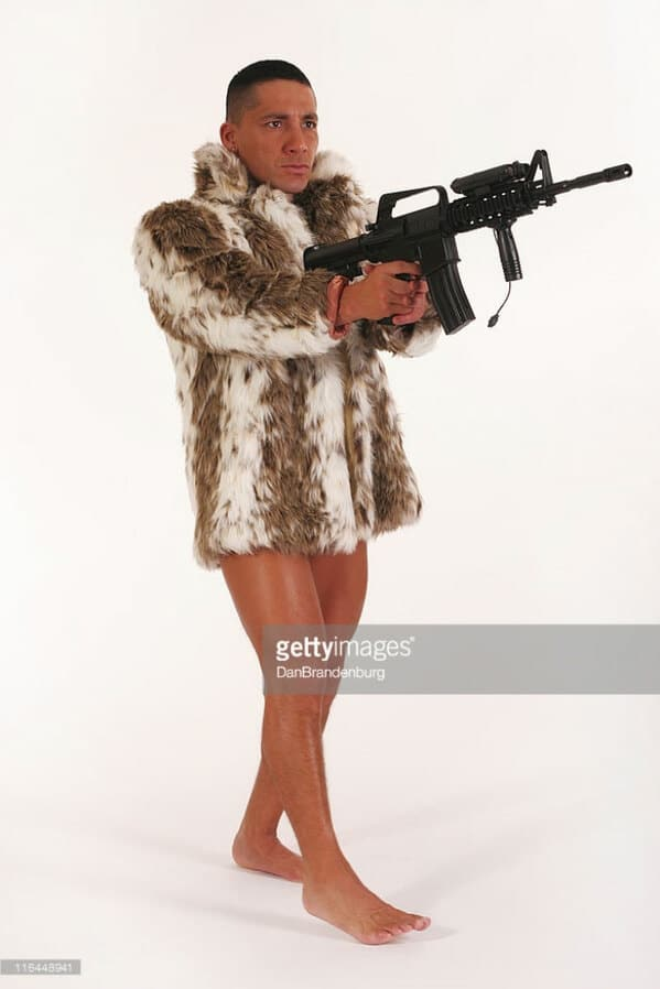 WTF stock photos man with gun and no pants in a fur coat