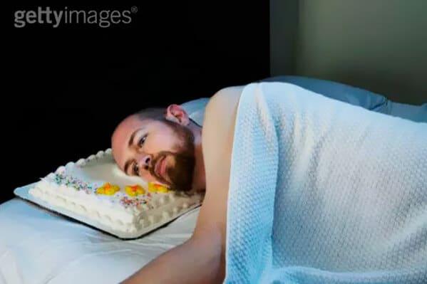 WTF stock photos man sleeps on a cake as a pillow