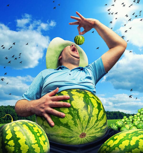 WTF stock photos watermelon stomach and a man eating a whole watermelon