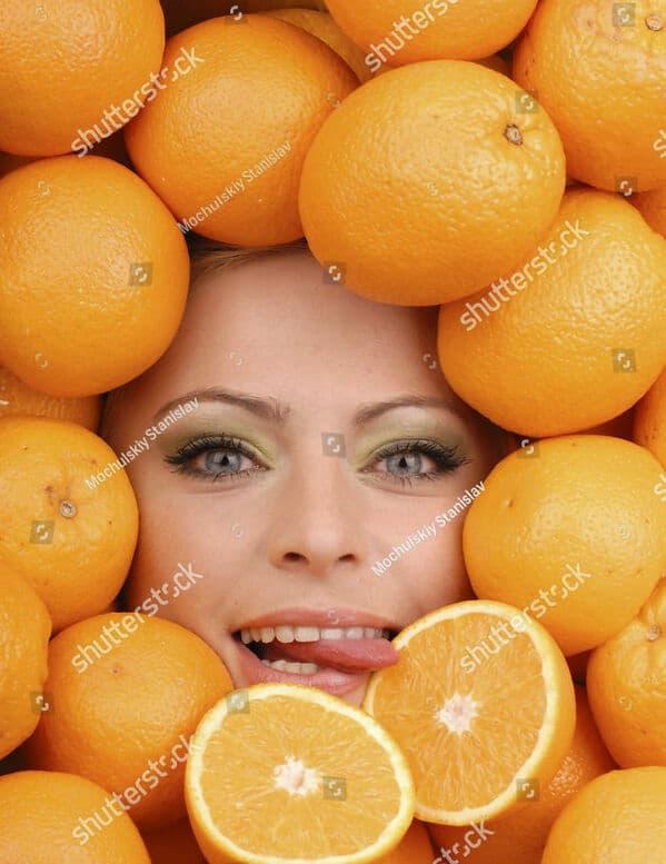 woman licking oranges WTF stock photos
