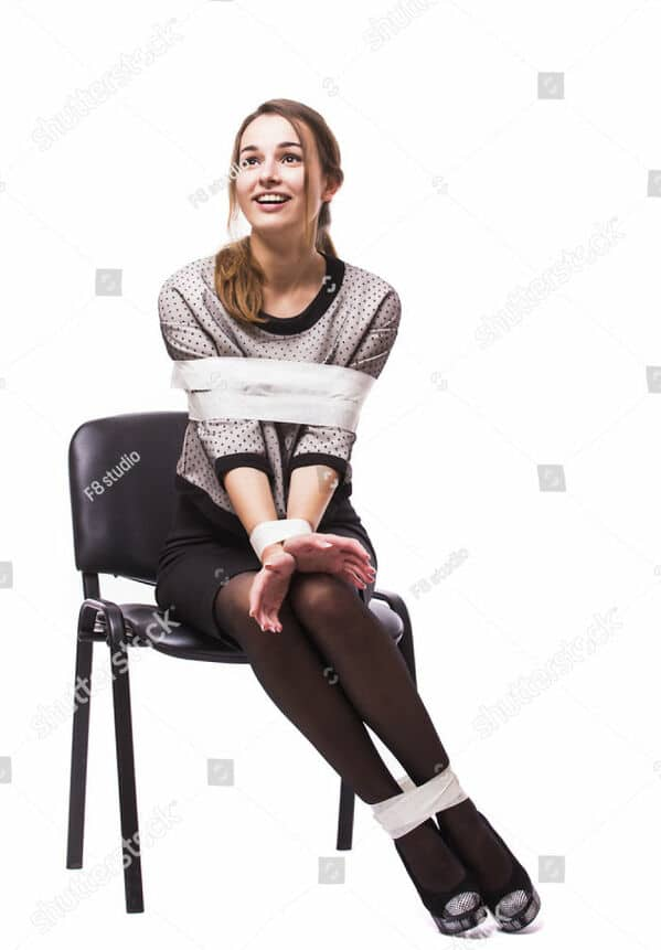 WTF stock photos woman tied up in a chair but she's happy
