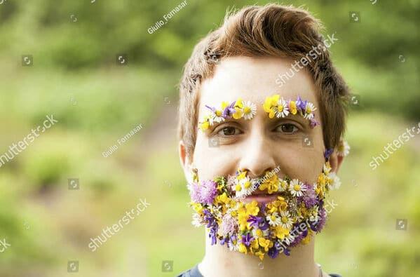 beard flower man WTF stock photos