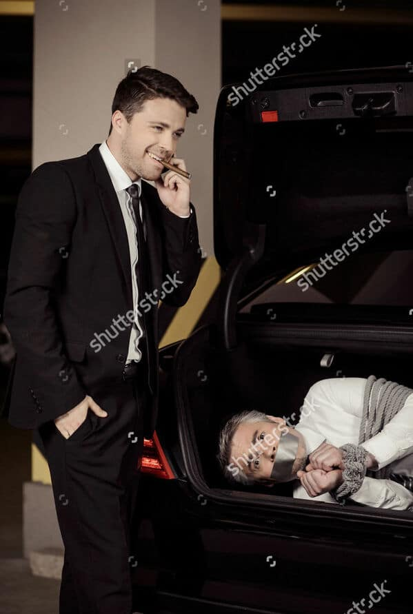 WTF stock photos man in the trunk of a car with duct tape over his mouth
