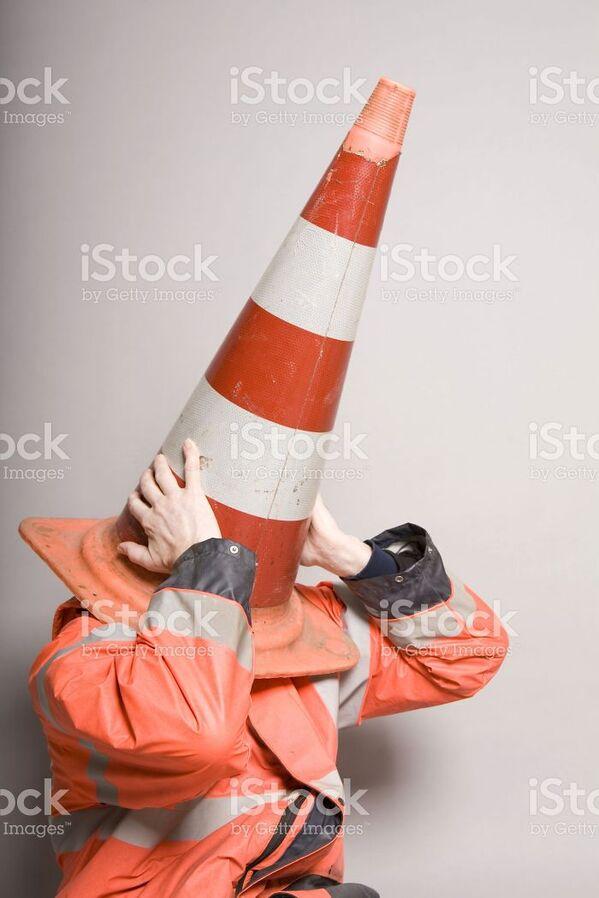 WTF stock photos traffic cone on head