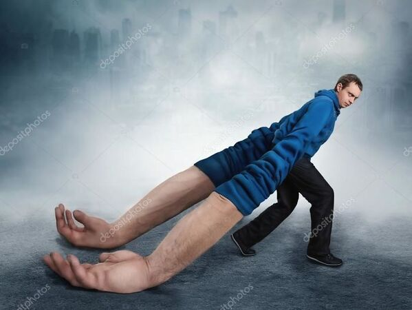 WTF stock photos man with huge hands dragging behind him