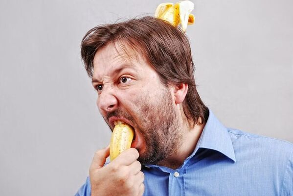 WTF stock photos banana in mouth and banana coming out of the back of his head