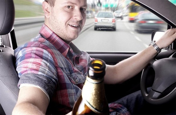 WTF stock photos drunk driver offering beer in car