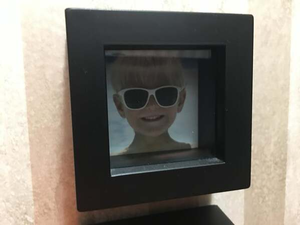 child in picture frame but it's a stock photo that came with the frame, funny people having a worse day, well that sucks
