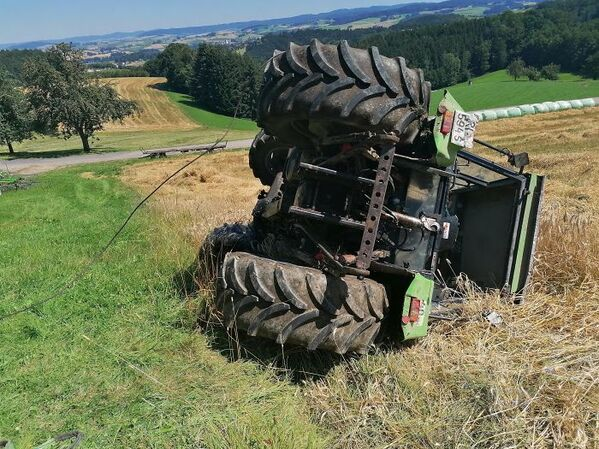 tractor on its side in a field, funny people having a worse day, well that sucks