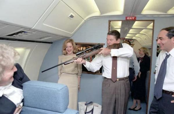 Reagan with a rifle on air force one, Funny Fake history photos, r fakehistoryporn, facts about history that are not true, false textbook photos, historical pics with funny captions, lol, jokes, old photos with hilarious explanations, funny pics