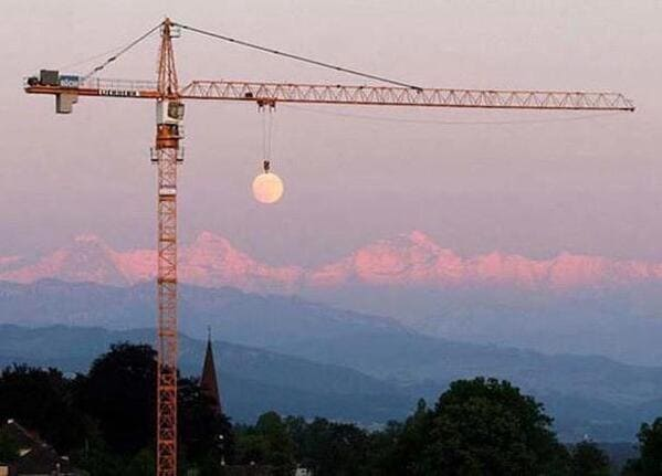 crane that looks like its carrying moon, Funny Fake history photos, r fakehistoryporn, facts about history that are not true, false textbook photos, historical pics with funny captions, lol, jokes, old photos with hilarious explanations, funny pics