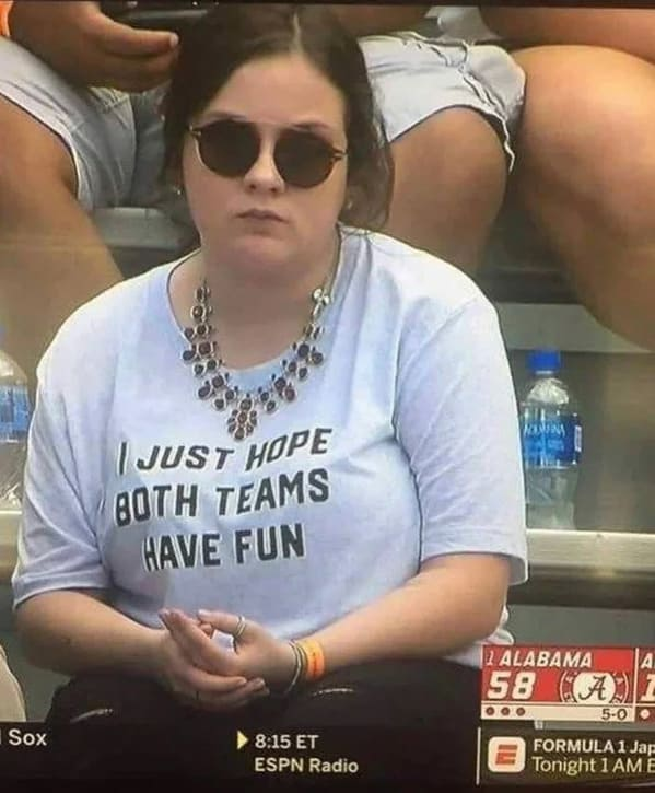 sad girl at sporting event with shirt saying I just hope both teams have fun, Funny Fake history photos, r fakehistoryporn, facts about history that are not true, false textbook photos, historical pics with funny captions, lol, jokes, old photos with hilarious explanations, funny pics