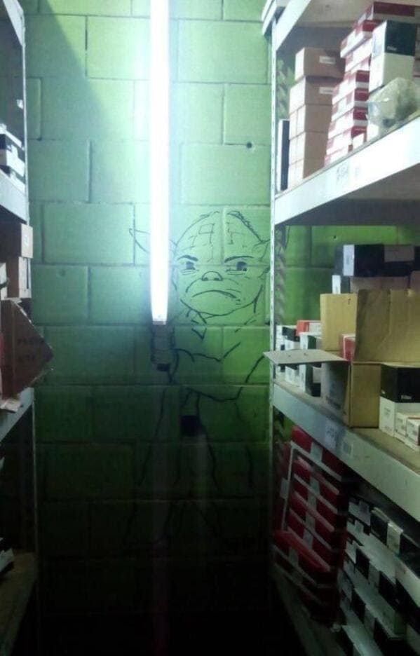 Yoda drawn on wall to make it look like he's holding a tube light, Mildly vandalised, mildly vandalized, funny photos of people who fixed signs, hilarious edits on road signs, funny people who added stuff to passive-aggressive signs, funny pics, lol, fixed it, nailed it