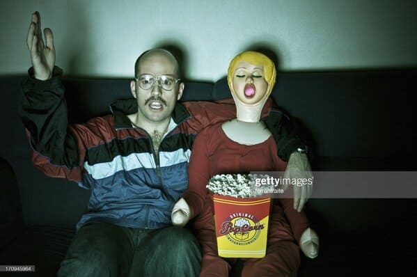 bald man with blowup doll in front of TV, Sexy stock photos twitter, funny wtf stock photos, innocent searches that led to weirdly sexualized stock photos, hot sexy men and women of shutterstock, Getty, hornystockphoto, twitter